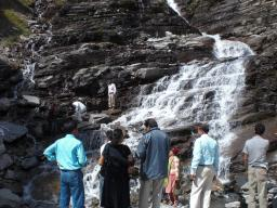 """Civil"" tourists enjoying the waterfall"