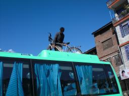 Loading the bike on the roof of deluxe bus in Manali. End of the cycling part of the trip.